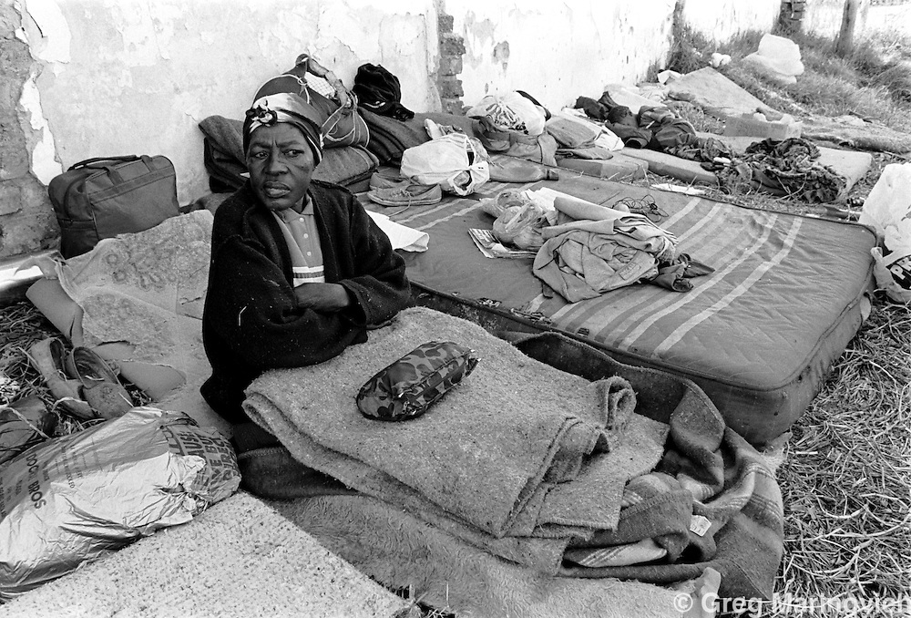 HOUSING  SOUTH AFRICA - Nov 1999: A homeless woman prepares to sleep on a winters evening in 1997 in the working class Johannesburg neighbourhood of Vrededorp, South Africa. (Photo by Greg Marinovich / Getty Images)