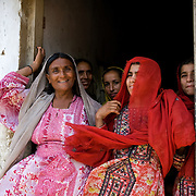 Family members of Mirzada stand in the doorway of their living quarters.<br /> Most people in Pakistan live in a joint family system. <br /> Women take care of the households and raise the children at home. Elderly people heavily rely on their children and grandchildren to provide for them when they get older. Karachi, Pakistan