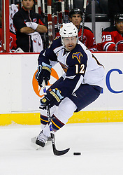 Nov 1, 2008; Newark, NJ, USA; Atlanta Thrashers center Todd White (12) skates with the puck during the first period at the Prudential Center.