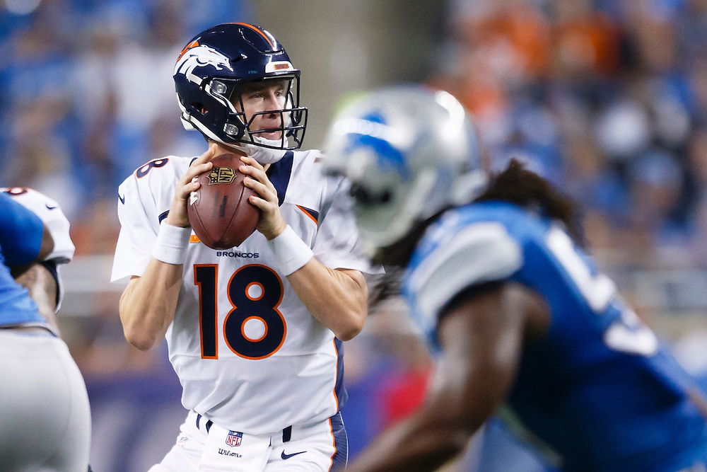 Denver Broncos quarterback Peyton Manning (18) drops back to pass against the Detroit Lions during an NFL football game at Ford Field in Detroit, Sunday, Sept. 27, 2015. (AP Photo/Rick Osentoski)