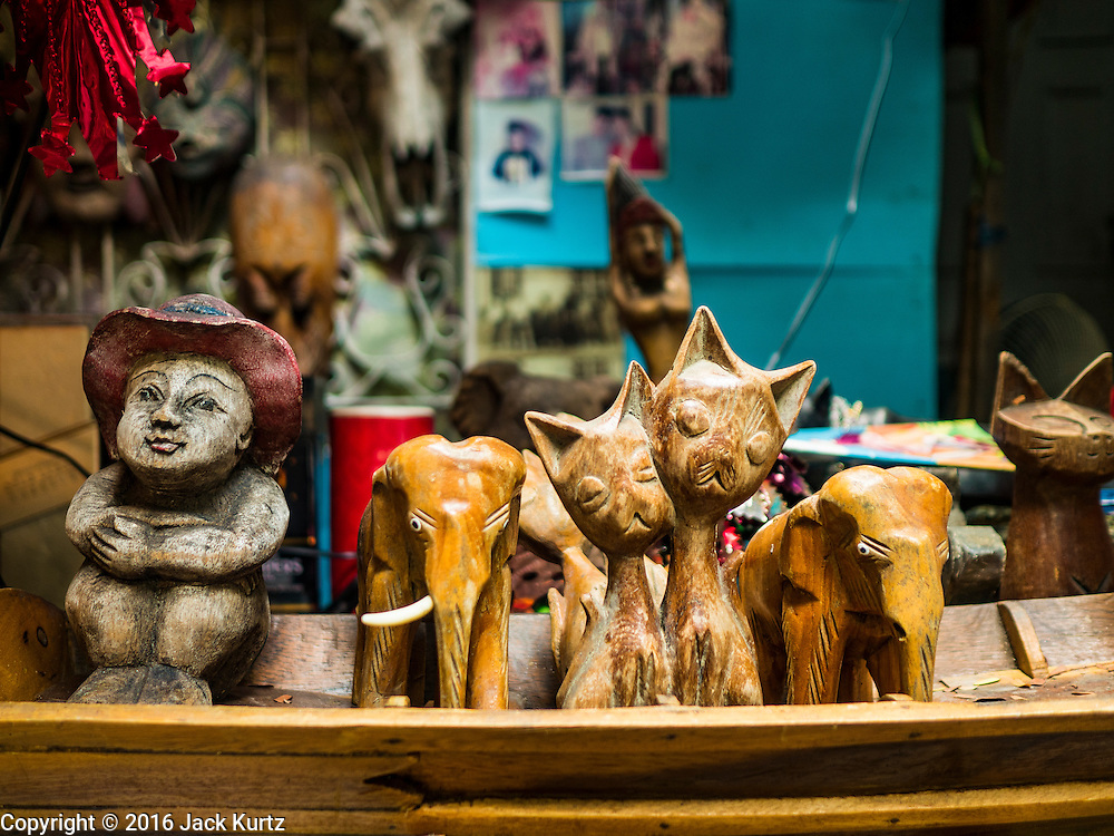 07 APRIL 2016 - BANGKOK, THAILAND: A family's wood carvings in front of their home in Mahakan Fort. Mahakan Fort was built in 1783 during the reign of Siamese King Rama I. It was one of 14 fortresses designed to protect Bangkok from foreign invaders, and only of two remaining, the others have been torn down. A community developed in the fort when people started building houses and moving into it during the reign of King Rama V (1868-1910). The land was expropriated by Bangkok city government in 1992, but the people living in the fort refused to move. In 2004 courts ruled against the residents and said the city could take the land. The final eviction notices were posted last week and the residents given until April 30 to move out. After that their homes, some of which are nearly 200 years old, will be destroyed.       PHOTO BY JACK KURTZ
