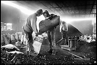 Palestinians manufacturing charcoal from burning wood at the west bank