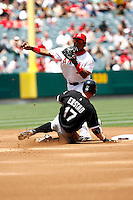 May 5, 2007: Second baseman Erick Aybar tags the base and throws the ball to first as former Angel Darren Erstad slides into it as the Chicago White Sox played the Los Angeles Angels of Anaheim at Anaheim Stadium in Anaheim, CA. White Sox defeated the Angels 6-3 in regulation..