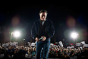 GOP presidential candidate Mitt Romney leaves a campaign rally in Henderson, Nevada strip mall, February 3, 2012.