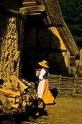 Image of a woman carrying water at Jamestown Settlement, Virginia, east coast