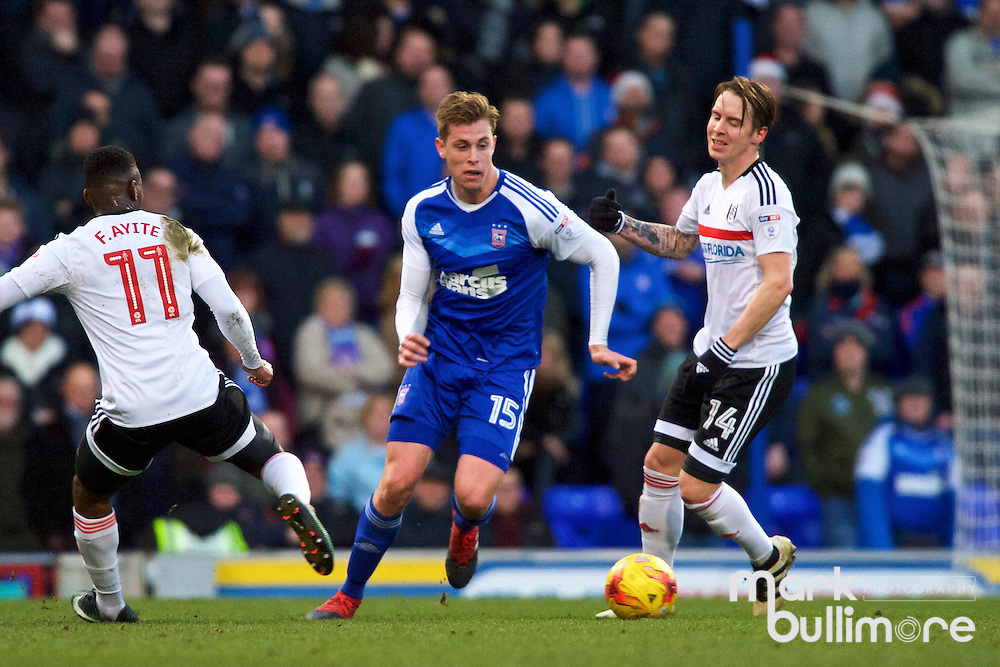 Ipswich, Suffolk. Football action from Ipswich Town v Fulham at Portman Road in the Sky Bet Championship on the 26th December 2016. Lone Ipswich Player Adam Webster  with Floyd Ayit&eacute; and Stefan Johansen.  <br /> <br /> Picture: MARK BULLIMORE