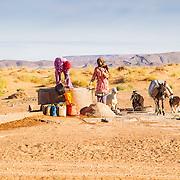 Arab woman; getting water, at well, near Erfoud; Morocco; People; Sahara Desert