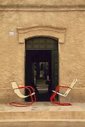Chairs and doorway to home on Calle Centenario in Todos Santos; Baja California Sur, Mexico.