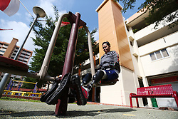 Aishah's working on an exercise machine in the park in front of her home apartment block in Singapore, 21 July 2014.  Aishah starts training to get back into shooting which includes training three times a week at an air rifle club and doing exercises in the park in front of her apartment block.