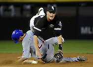 CHICAGO - JUNE 26:  Gordon Beckham #15 of the Chicago White Sox is upended while turning a game ending double play over the sliding Tyler Colvin #21 of the Chicago Cubs on June 26, 2010 at U.S. Cellular Field in Chicago, Illinois.  The White Sox defeated the Cubs 3-2.  (Photo by Ron Vesely)
