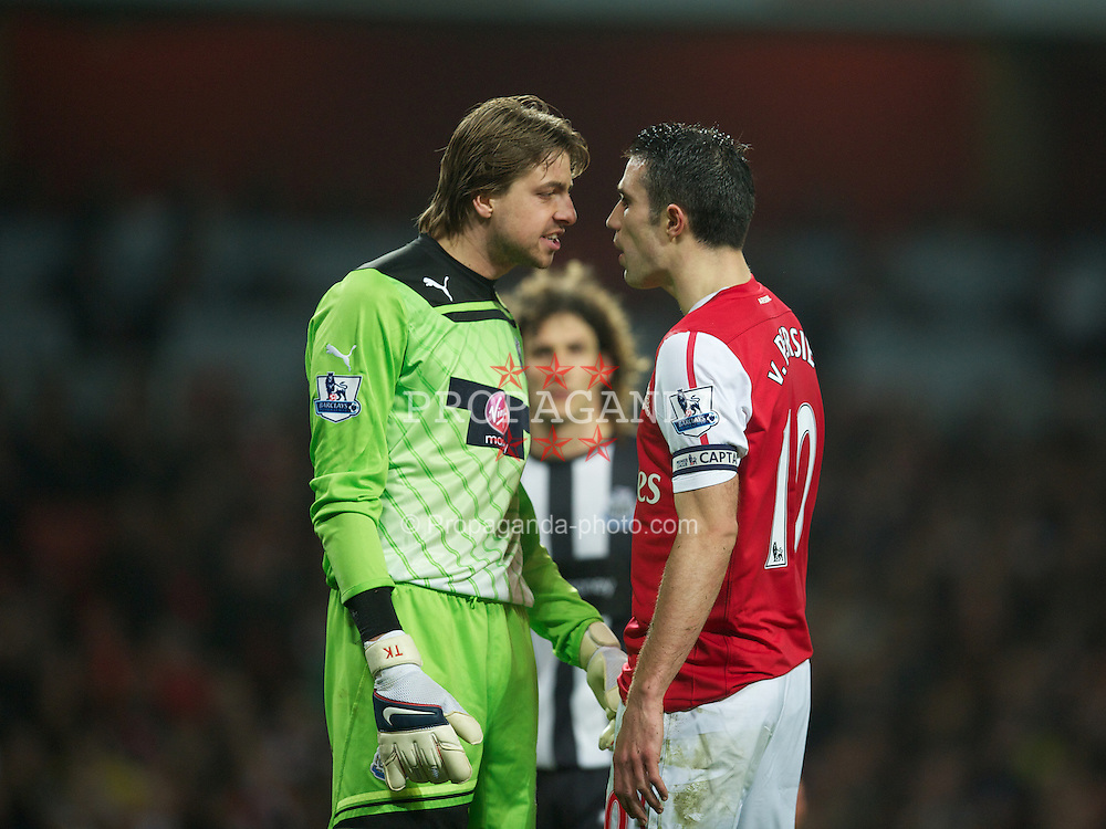 LONDON, ENGLAND - Monday, March 12, 2012: Arsenal's Robin Van Persie goes head-to-head as he clashes with Dutch international team-mate Newcastle United's goalkeeper Tim Krul during the Premiership match at the Emirates Stadium. (Pic by David Rawcliffe/Propaganda)