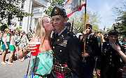 A cadet at the Benedictine Military School gets kissed while marching in the 191st St. Patrick's Day parade, Tuesday, March 17, 2015, in Savannah, Ga. The St. Patrick's Day tradition in Savannah dates back to the first parade held on March 17, 1824. (AP Photo/Stephen B. Morton)