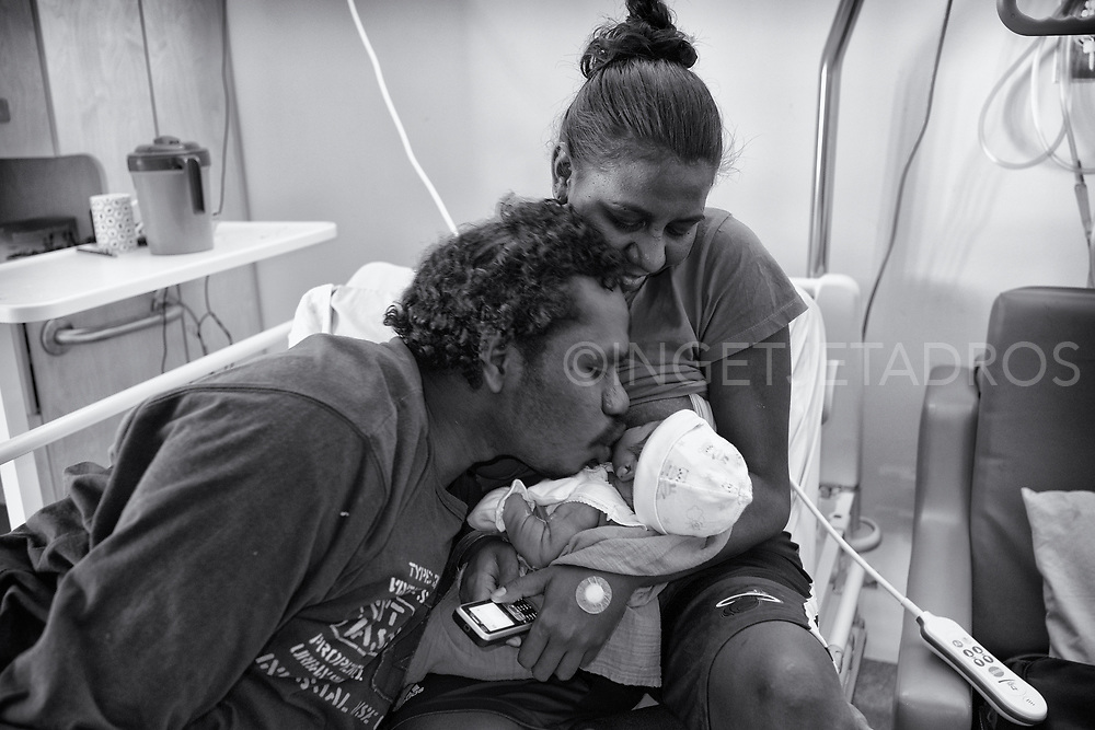 Kenny kissing his first born son Jahim while Cherilyn is watching with a big smile. <br /> Both are living in the Looma community over two hours drive North of Broome. Cherlilyn gave birth at the Broome Hospital. Broome, Western Australia.