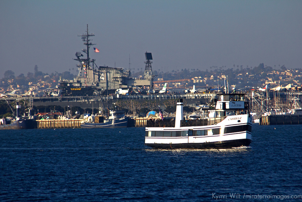 USA, California, San Diego. The San Diego Coronado Passenger Ferry and the USS Midway.