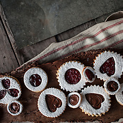 A rustic valentine's day cookie shoot. These are Italian Occhi di Bue cookies in the shape of hearts as well as circles. Occhi di Bue means cow's eyes due to the large circles filled with jam or Nutella.