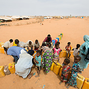 People collecting water at the Mbera camp for Malian refugees in Mauritania on 2 March 2013. Inadequate supplies of water, particularly in the new areas of the camp, are placing additional pressure on water points such as this one, leading to conflict.