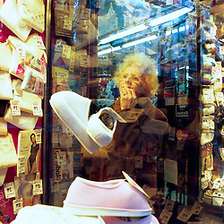 BUENOS AIRES, ARGENTINA:  A woman shops at a local store in Buenos Aires. .(Photo by Ami Vitale)