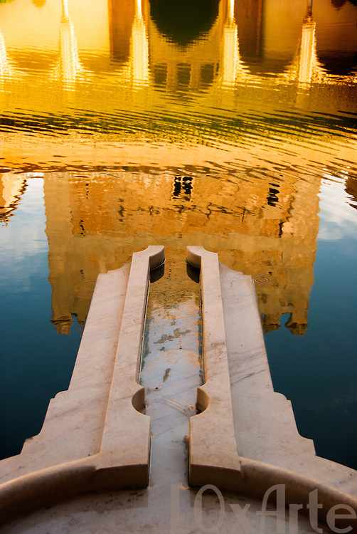 Reflection of the Comarec Tower in the pond of the Court of the Myrtles in the Alhambra, Granada, Spain