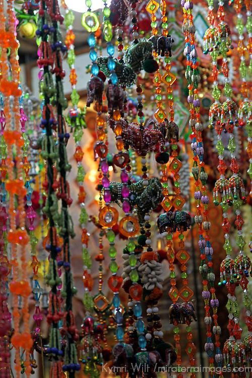 Asia, India, Delhi. Colorful strands of beads hang in market in Old Delhi.