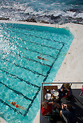 Sydney Sites travel series. View of the Bondi Ice Bergs ocean pool from Sydney's Bondi to Bronte walk featuring a new cafe on a Saturday morning.