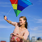 SHOT 5/7/2006 - Larimer Square 2006 spring fashion campaign. Flying a kite with the skyline of Denver, Co. in the background..(Photo by Marc Piscotty/ © 2006)