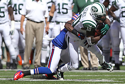 Sept 9, 2012; East Rutherford, NJ, USA; New York Jets wide receiver Santonio Holmes (10) is tackled after making a catch during the first half at MetLIfe Stadium.