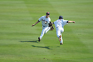 Ole Miss' Auston Bousfield and Ole Miss' Alex Yarbrough are unable to catch a ball hit by LSU's Grant Dozar  at Regions Park in the SEC Tournament in Hoover, Ala. on Thursday, May 24, 2012.  .LSU won 11-2.