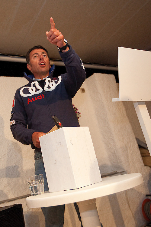 Mascalzone Latino's Flavio Favini takes over the hammer at a charity auction during the Louis Vuitton Trophy, La Maddalena, Italy. 1 June 2010. Photo: Gareth Cooke/Subzero Images