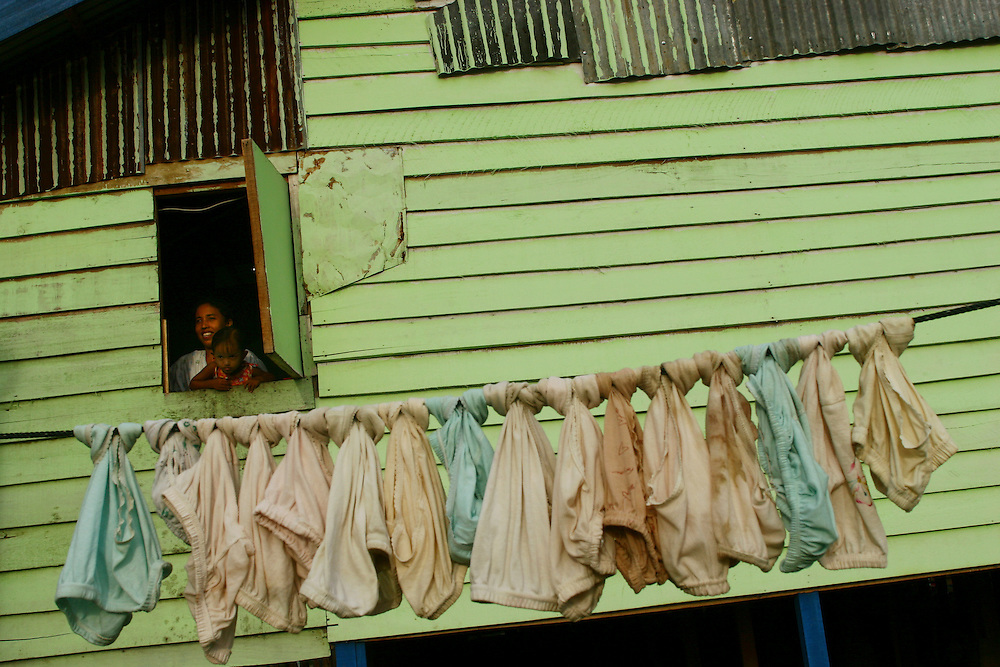 Woman by window in Long Barracks. @ Martine Perret. February 2006
