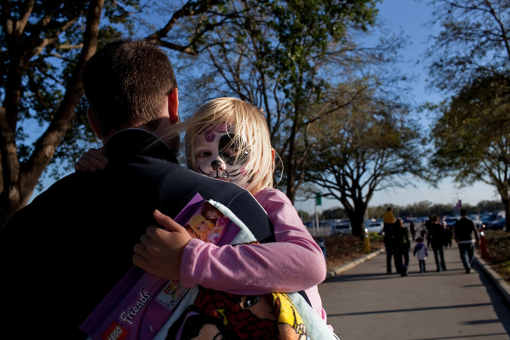 Andrew Jones carries his daughter Hannah Jones, 5, after a long day at Legoland in Whitehaven, Florida on February 11, 2012.