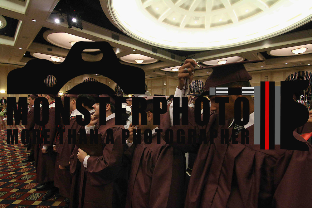 D.A.P.S.S graduates participate in the tassel ceremony portion of D.A.P.S.S inaugural commencement exercise Friday, June 05, 2015, at The Case Center on The River Front in Wilmington, Delaware.