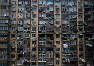 Clothes are set to dry outside apartments in a building complex in Shanghai, China, Saturday, May 30, 2009. Block after city block, towers of concrete, steel and glass fill the skyline. .Teeming and congested, the intensely urban landscapes of China's biggest cities show a glimpse of what the future will hold for the rest of the country.In the sprawling megacities of Beijing, Shanghai and Chongqing, where populations exceed 10 million people, extreme urban density means that the number of people living within a few square blocks here is equal to the population of entire mid-size U.S. cities. .China's urban population soared to 607 million people last year _ nearly equaling the 700 million living in the countryside. The country's headlong plunge toward urbanization continues unabated as tens of millions of migrants from the countryside flood to cities in search of money, jobs and other opportunities