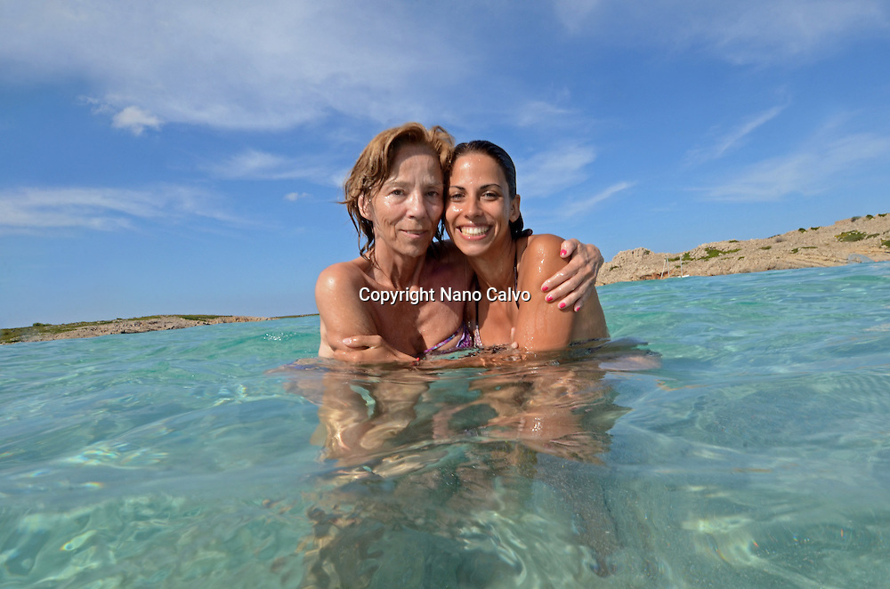 Mother and daughter have fun in the pristine waters of Menorca