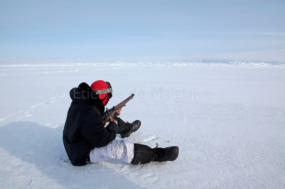 Canadian Rangers  practice shooting on icepack off Gascoyne Inlet (Devon Island, Nunavut) during Nunalivut 2012 sovereignty exercise by Canadian Forces in arctic Canada. The Rangers were issued old .303 rifles for self defense and hunting. Because of growing lack of spare parts, the WWII era weapon will be replaced soon. Rangers are army units that mix Inuit, local volunteers and professional military acting as eyes and ears in the most remote areas of northern Canada.