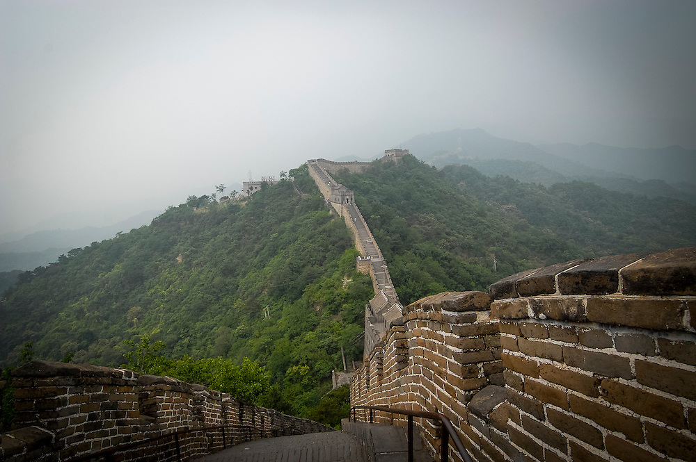 Grande Muraille de Chine<br /> Great Wall of China<br /> <br /> The Great Wall of China is a series of fortifications made of stone, brick, tamped earth, wood, and other materials, generally built along an east-to-west line across the historical northern borders of China to protect the Chinese states and empires against the raids and invasions of the various nomadic groups of the Eurasian Steppe. Several walls were being built as early as the 7th century bce; these, later joined together and made bigger and stronger, are now collectively referred to as the Great Wall. Especially famous is the wall built 220&ndash;206 bce by Qin Shi Huang, the first Emperor of China. Little of that wall remains. Since then, the Great Wall has on and off been rebuilt, maintained, and enhanced; the majority of the existing wall is from the Ming Dynasty.<br /> <br /> The Great Wall stretches from Dandong in the east, to Lop Lake in the west, along an arc that roughly delineates the southern edge of Inner Mongolia. A comprehensive archaeological survey, using advanced technologies, has concluded that the Ming walls measure 8,850 km. This is made up of 6,259 km sections of actual wall, 359 km  of trenches and 2,232 km of natural defensive barriers such as hills and rivers. Another archaeological survey found that the entire wall with all of its branches measure out to be 21,196 km.