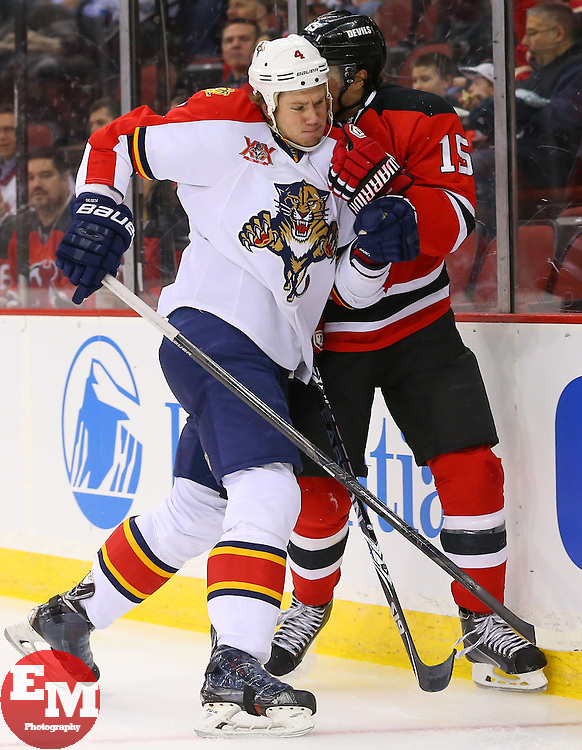 Mar 31, 2014; Newark, NJ, USA; Florida Panthers defenseman Dylan Olsen (4) hits New Jersey Devils left wing Tuomo Ruutu (15) during the first period at Prudential Center.