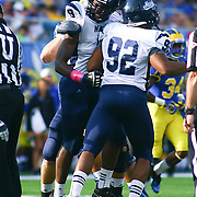 University of Maine defensive lineman Douglas Alston (9) get excited after sacking Delaware Quarterback Trent Hurley in second quarter of a Week 6 NCAA football game against Delaware.