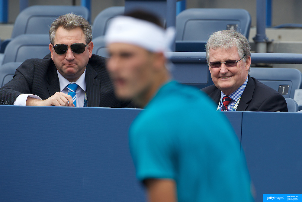 Australian Tennis Officials Steve Wood (left) and Geoff Pollard watching Bernard Tomic, Australia, in action against Alexander Domijan, USA, in the Boy's Singles Championships during the US Open Tennis Tournament at Flushing Meadows, New York, USA, on Wednesday, September 9, 2009. Photo Tim Clayton.