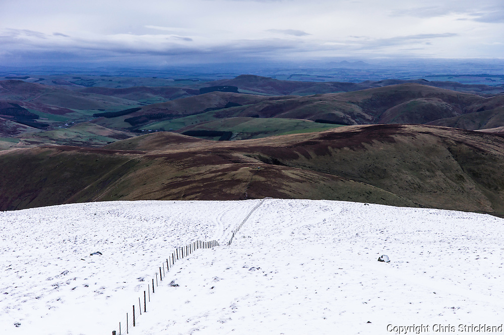 Cheviot Hills, Yetholm, UK. 13th January 2016. Looking north west from the Cheviot Auchope Cairn (726m).