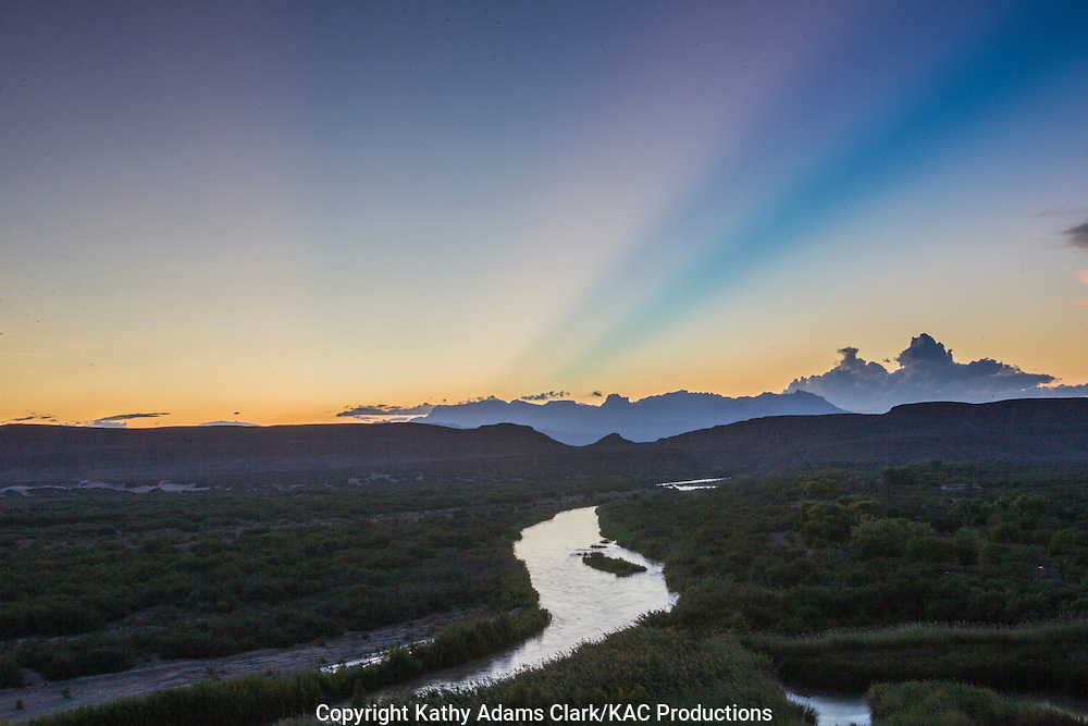 Rio Grande leading to the Dead Horse Mountains with Crepuscular Rays in the evening sky at Big Bend National Park, Texas. Vantage point is the