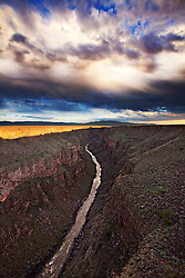 Late afternoon light strikes the rim of the Rio Grande Gorge, near Taos, New Mexico.