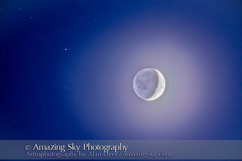 The 4.5-day-old waxing crescent Moon in the deep blue twilight sky, with stars of Capricornus around the Moon including Beta Capricorni at left that the Moon occulted later that evening. This was November 26, 2014, from New Mexico. <br /> <br /> This is an HDR stack of 12 exposures at 1-stop increments from 4 secodns to 1/500th second at ISO 400 with the Canon 6D and thru the TMB 92mm apo refractor at f/6 with the Hotech field flattener. Composited and tone-mapped in Photoshop HDR Pro and ACR. Mount running at the Lunar drive rate.