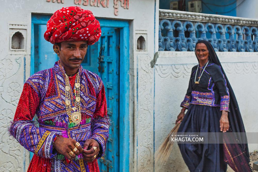 A gujarati groom of Maldhari community standing outside ...