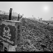 A sign post marking location of landmines is seen on a road near Pailin, Cambodia.  Thirty years of war and civil war has left Cambodia one of the most heavily mined nations in the world.