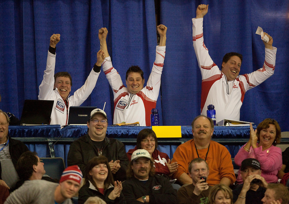 Members of Team Canada had something to celebrate during their loss to Norway in the evening draw at the Ford World Men's Curling Championships at the Brandt Centre in Regina, Saskatchewan, April 7, 2011. The team walked away with nearly $19,000 in the 50/50 draw.<br /> AFP PHOTO/Geoff Robins