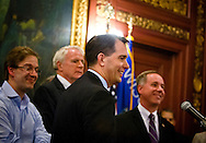 MADISON, WI – JUNE 4: Governor Scott Walker (R-WI) laughs at the close of a press conference in the Wisconsin capitol building surrounding the construction of a new basketball arena for the Milwaukee Bucks, Thursday, June 4, 2015.