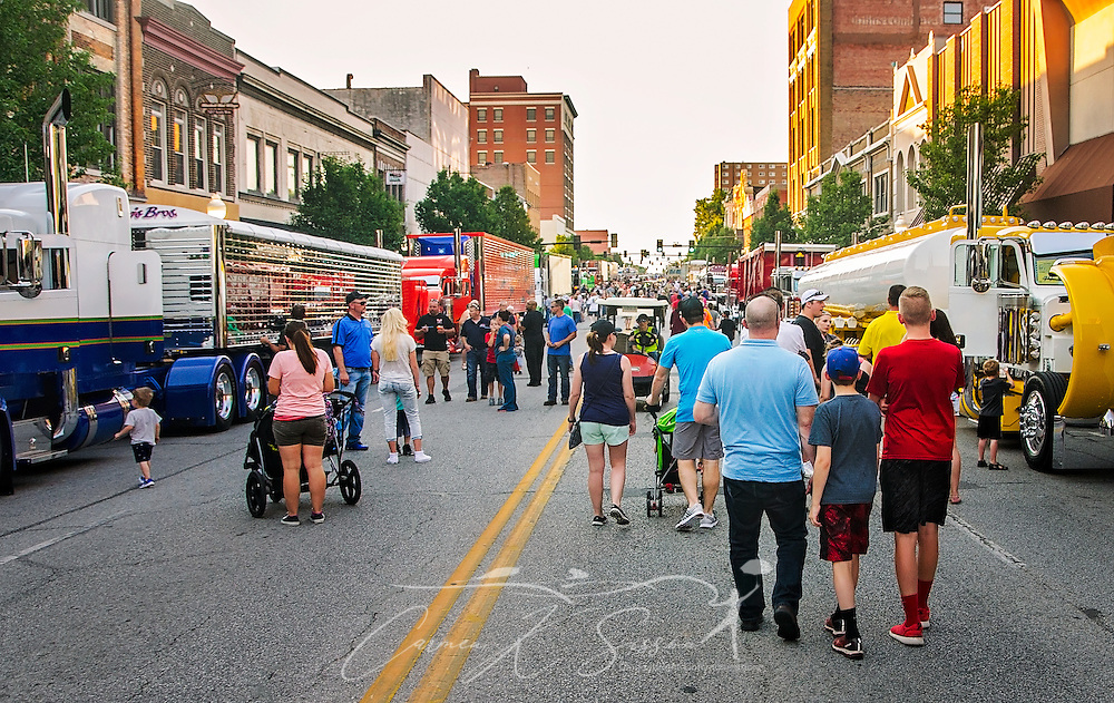 A crowd of people inspects big rigs on Main Street during the 34th annual Shell Rotella SuperRigs, June 10, 2016, in Joplin, Missouri. SuperRigs, organized by Shell Oil Company, is an annual beauty contest for working trucks. Approximately 89 trucks entered this year's competition. (Photo by Carmen K. Sisson/Cloudybright)