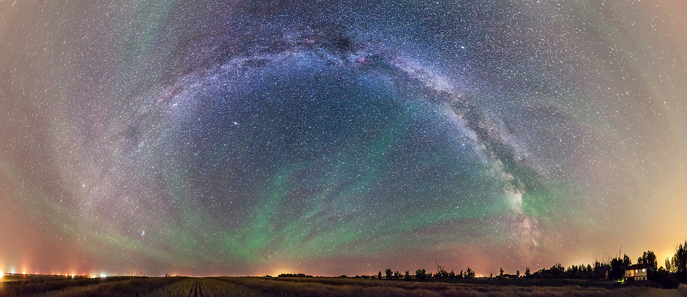 An 8-section panorama of the summer Milky Way over a harvested canole field next to my house in rural Alberta. Taken with the 14mm lens, vertically, each segment at 45° spacings, for 60 seconds at f/2.8 and Canon 5D MkII at ISO 5000. Stitched in PTGui with Spherical projection.