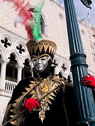 Masked man in Carnival or Carnevale in Venice Italy