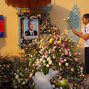 Cambodians gather in Phnom Penh Monday, Feb. 4, 2013, to offer prayers for former King Norodom Sihanouk who passed away in Beijing, China on Oct. 15, 2012.  Cremation ceremonies for Sihanouk are set of Feb. 4, 2013 in Phnom Penh.